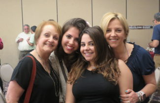 Sisters and LAHHS alumni, Camila (left of middle) and Bianca (right of middle), with proud mom/LAHHS teacher, Mariel Seta.